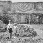 Image of Peter Woods and his sister in the Woodrow house garden. circa 1943-44