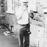 Former school caretaker, Charlie Wharf, showing drinking cups