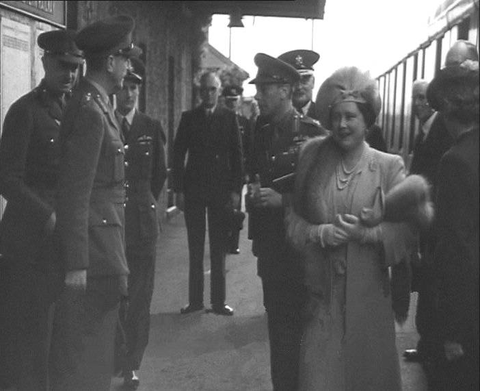 King and Queen meet dignitaries on the platform